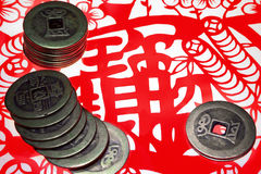 Chinese old copper coins and paper-cut Royalty Free Stock Photos