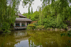 Chinese old-fashioned building by water Stock Photos