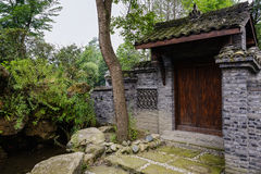 Chinese old-fashioned gate in sunny summer Stock Images