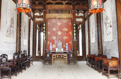 Chinese old house. Building interior of Chinese old house with wooden table and chair Royalty Free Stock Photo