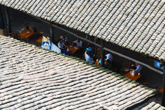 Chinese old house. Under Chinese old house, the eaves of people playing cards tea break royalty free stock photo