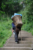 Chinese old man carry bottled water. In the mountains,in Sichuan,China Royalty Free Stock Photo