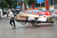Chinese old man carry goods Stock Image