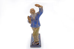 Chinese Old Man Dancing Tai Chi Statue on White Background Stock Image