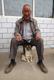 A Chinese old man and his dog Royalty Free Stock Photos