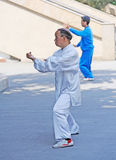 Chinese old man are playing taiji Stock Photography