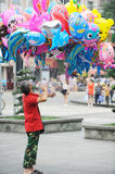 Chinese old man  selling  balloon Stock Image