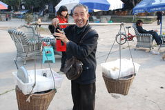 Chinese old man street seller Stock Image