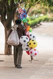 Chinese old man street vendor seller ball and other toys on the royalty free stock image