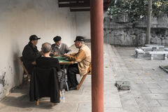Chinese old men enjoy leisure time Stock Photo
