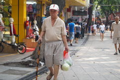 Chinese old people walking in the street Stock Image