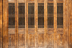 Chinese old style door. Chinese old wooden door  in a  ancient building,this style is used in several hundred years ago Royalty Free Stock Image