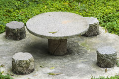 Stone table set in garden Royalty Free Stock Image