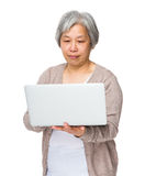Chinese old woman use of notebook computer stock photos