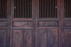 Chinese old wooden door in a ancient building royalty free stock photo
