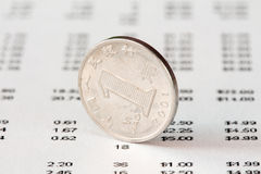 Chinese One Yuan coin and financial report. Rate of the Chinese Yuan Stock Images