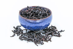 Chinese Oolong Dark Red tea WuYi Rou gui in a blue ceramic bowl royalty free stock photos