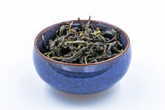 Chinese Oolong Green tea. Feng Huang Dan Cong in a blue ceramic bowl. royalty free stock images