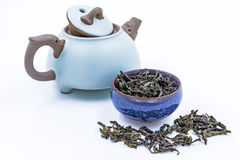 Chinese Oolong  Green tea. Feng Huang Dan Cong in a blue ceramic bowl. Chinese Oolong Green tea. Feng Huang Dan Cong in a blue ceramic bowl with small clay pot Royalty Free Stock Photography