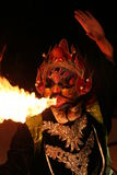 Chinese opera. Masked perfomer breathing fire during Sichuan opera Royalty Free Stock Photography
