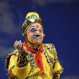 Chinese opera actor. Perform face off by mask of face painting Royalty Free Stock Photography