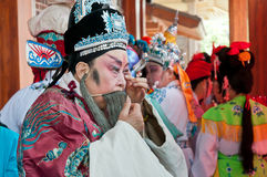 Chinese opera actor makeup in the background Stock Image