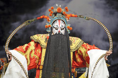 Chinese opera actor with traditional costume. Chinese traditional opera actor peforms on stage with theatrical costume and facial painting Stock Photos