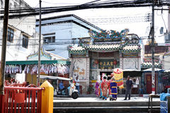 Chinese opera actors walking across the street to offering Shrine of the Black Sea Royalty Free Stock Photos