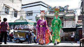Chinese opera actors walking across the street to offering Shrine of the Black Sea Stock Images