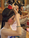 Chinese opera actress painting face at backstage Stock Photo