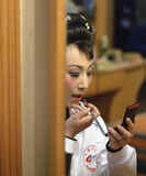 Chinese opera actress is painting her face Royalty Free Stock Photography