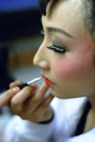 Chinese opera actress is painting her face Stock Photography