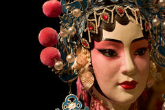 Chinese opera dummy and black cloth as text space Stock Photos