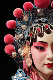 Chinese opera dummy and black cloth as text space Stock Image