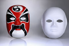 Chinese opera mask and white mask Royalty Free Stock Image