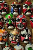 Chinese opera masks on a wall Stock Photos