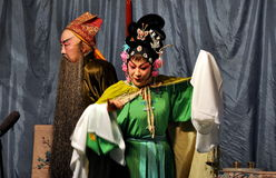 Chinese Opera Performers. Two actors performing in a highly stylised and costumed traditional Peking Chinese opera at a local teahouse in Pengzhou, China Stock Image