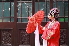 Chinese opera woman.Practicing Peking Opera in the garden, Colorful, china Stock Image