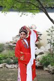 Chinese opera woman.Practicing Peking Opera in the garden, Colorful, china Stock Images