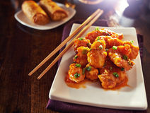 Chinese orange chicken. With chopped green onion shot in copy space composition royalty free stock images
