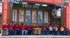 Chinese Orchestra. A Chinese orchestra plays traditional Chinese instruments on stage at the Third Month Fair, a 5,000 year old fair in Dali, Yunnan province Stock Photos