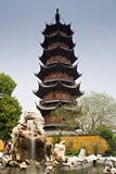 Chinese Pagoda. Longhua Pagoda, dating from the Song period, and fountain, taken in Longhua Temple, Shanghai, China royalty free stock photo