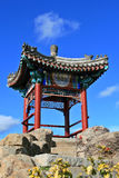 Chinese Pagoda. A Chinese Pagoda with steps leading up a path to it Stock Photo