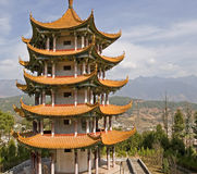 Chinese Pagoda in Mountain Valley. A Chinese pagoda stands on a hillside in a mountain valley in Yangbi, Yunnan province, southern China Royalty Free Stock Photo