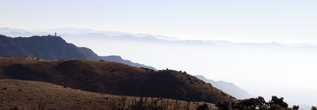 Chinese Pagoda on Mountaintop. A distant Chinese pagoda stand atop Chicken Foot Mountain, overlooking the misty expanse below Royalty Free Stock Photography