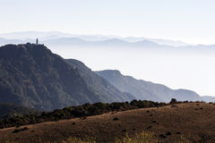 Chinese Pagoda on Mountaintop. A Chinese pagoda stand atop Chicken Foot Mountain, overlooking the misty expanse below Royalty Free Stock Photos