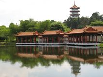 Chinese Pagoda & Pavilion. A Chinese Pagoda and Pavilion with reflections in the water found at Singapore Chinese Garden Stock Photography