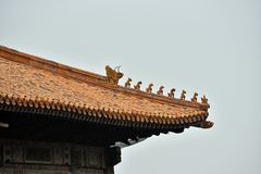 Chinese pagoda rooftop statues. A view of animal statues on the rooftop on a pagoda in the forbidden palace in Beijin, China stock images