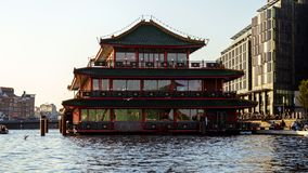 Chinese pagoda style floating resaurant in Amsterdam canal, October 13, 2017 royalty free stock photography