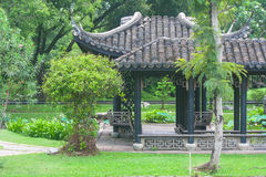 Chinese pagoda surrounded with green trees. At public park stock photography